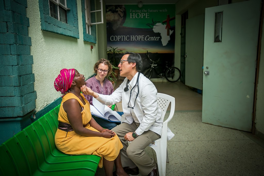 Dr. Michael Chung and PhD student Sharon Greene examine a patient.