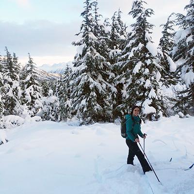 Emily Mosites hikes through snow in Alaska.