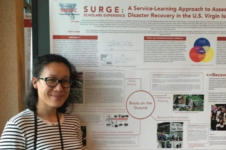 Epi MPH student Christina Sun shares her research during a poster presentation.