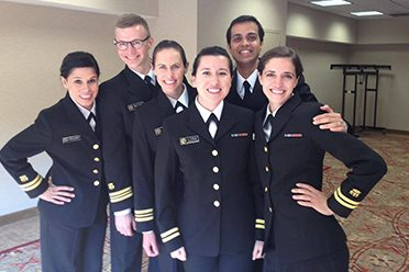 Mosites joined the EIS as a commissioned officer. She is pictured above on the right at her officer basic course.