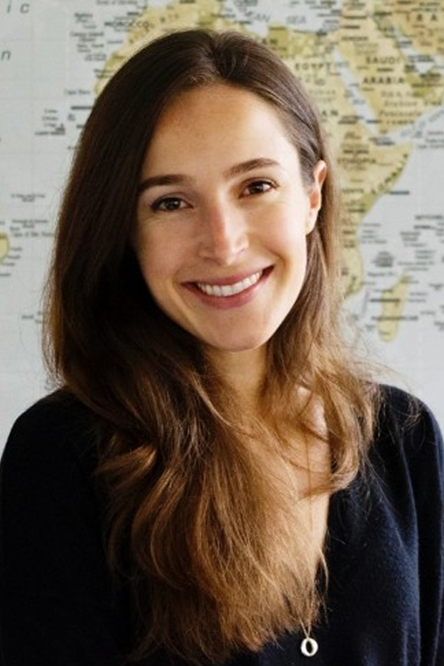 Claire Rothschild headshot in front of a world map